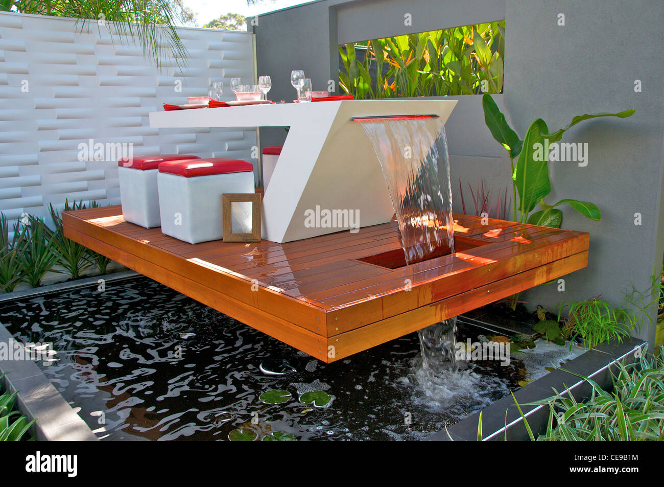 Contemporary dining table water feature stock photo