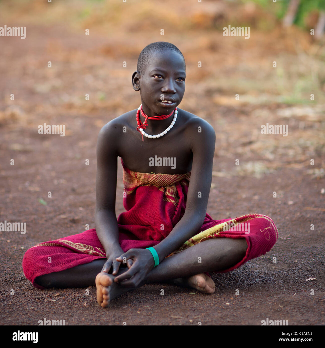 loincloth  boy Stock Photo - Teenage Bodi Boy Wearing Loincloth Sitting On The Floor Omo  Valley Ethiopia