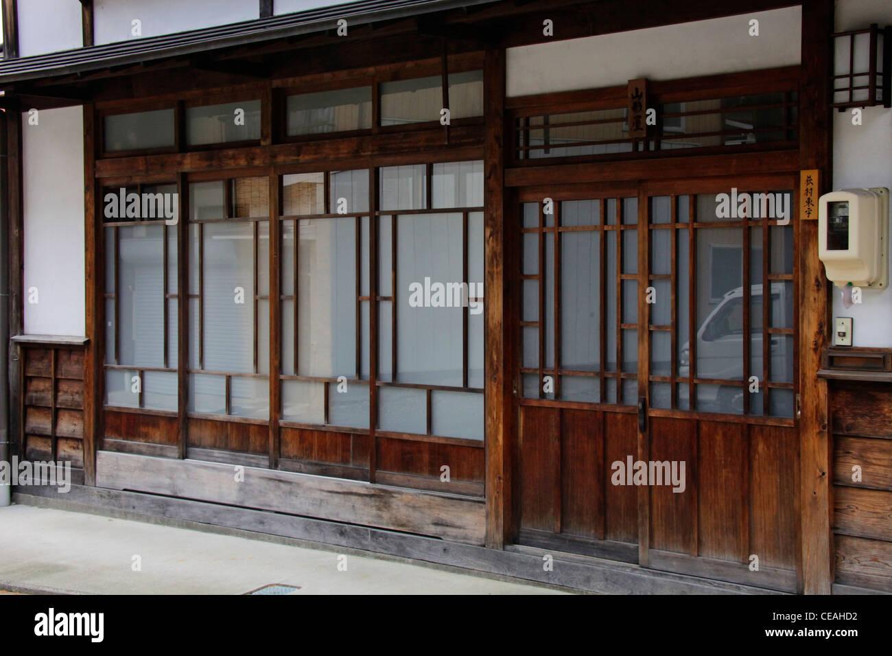Lattice doors and windows of a house at Narai-juku historic town of Kisoji Nagano Japan & Lattice doors and windows of a house at Narai-juku historic town of ...