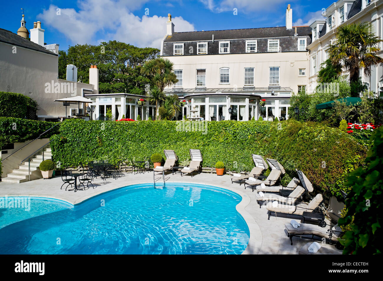 Swimming pool and garden of the ogh hotel st peter port for Garden swimming pool uk