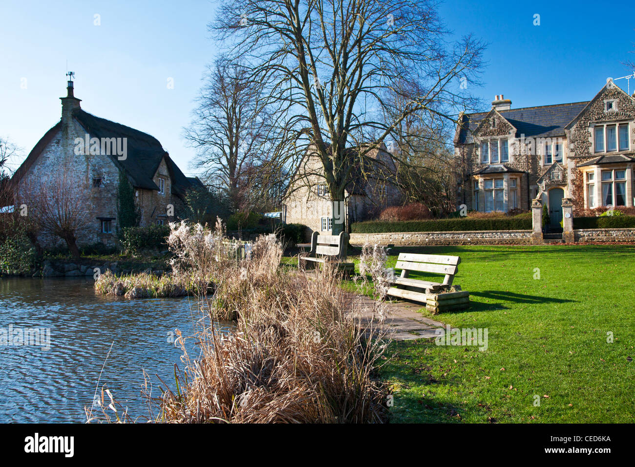 Houses Around A Typical English Village Duck Pond On The