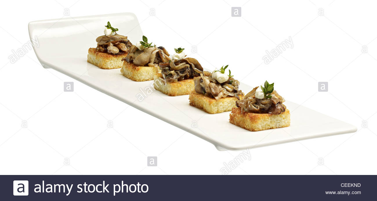 Mushroom pate canape white serving tray stock photo for Canape serving platters