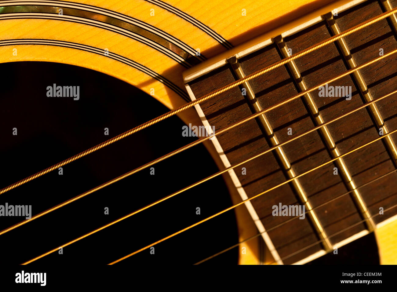 Close Up View Of Acoustic Guitar Showing Strings Sound Hole Part Upper Fretboard And Decorative Pattern Work