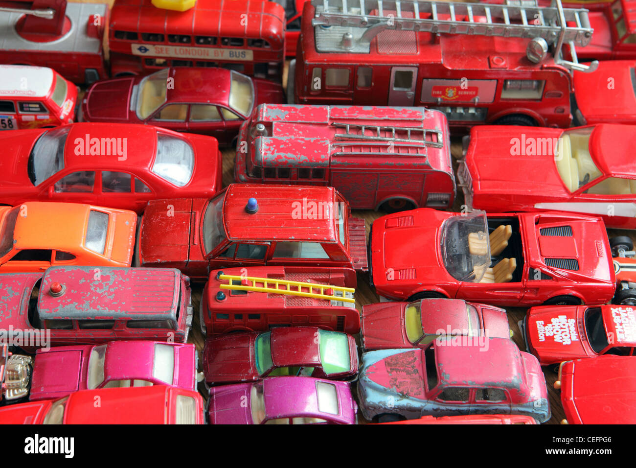 Different Shades Of Red traffic jam of red model cars, all different shades of red, home