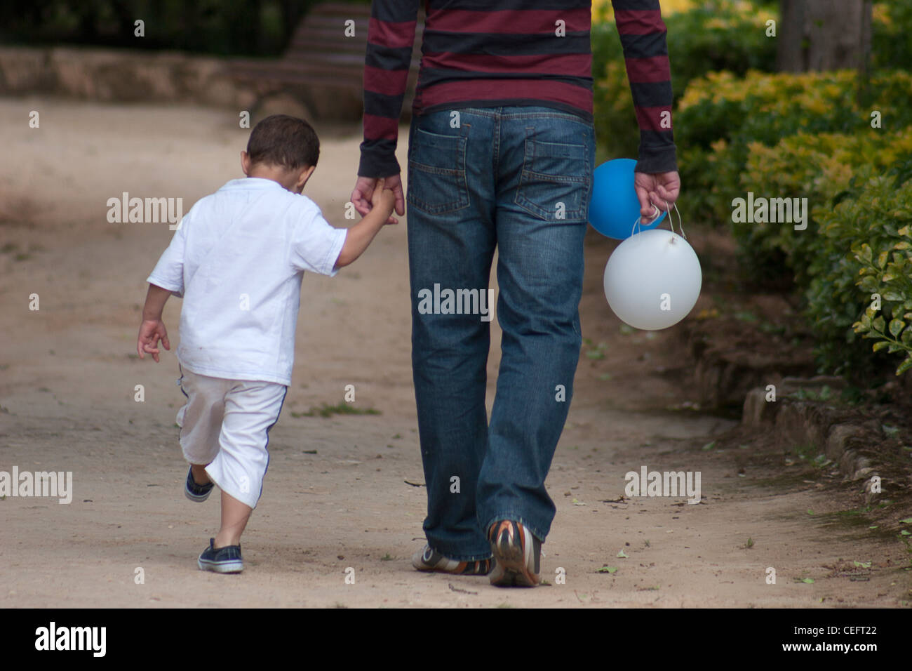 little-boy-holding-fathers-hand-CEFT22.j
