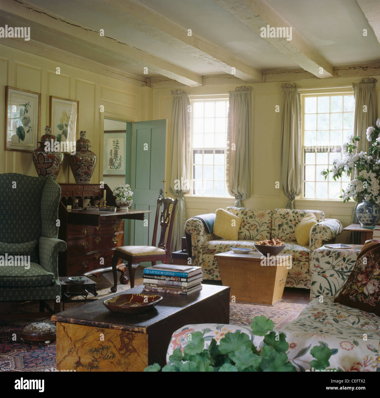 Old Painted Pine Chests And Floral Sofas In Country Living Room With Cream  Painted Ceiling Beams