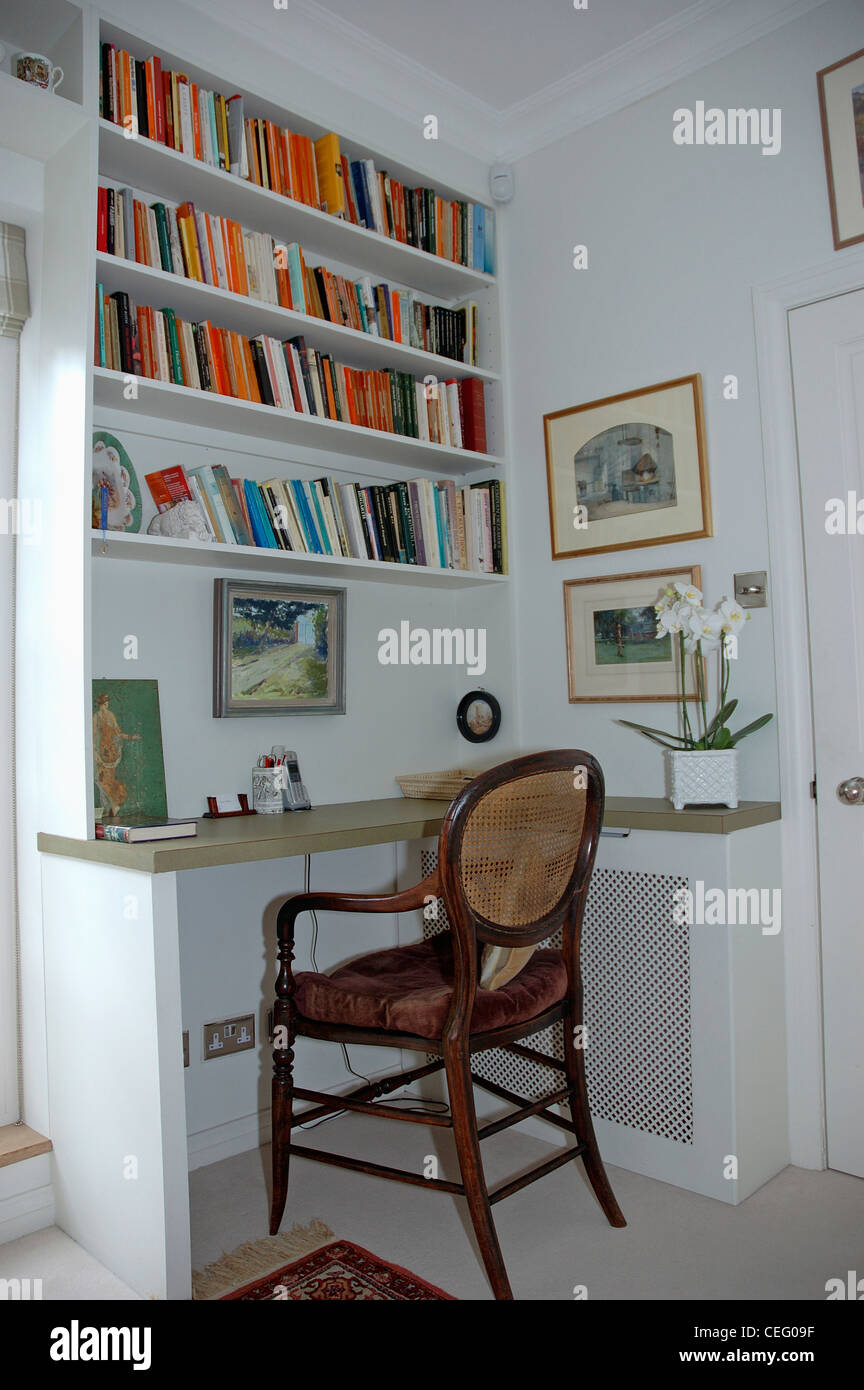 Antique Chair At Fitted Desk Below Bookshelves In Study Corner Of Apartment Living Room