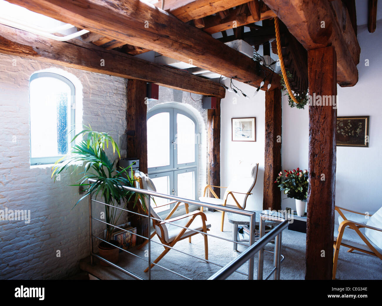 Converted Warehouse large rustic wooden beams in apartment hall in converted warehouse
