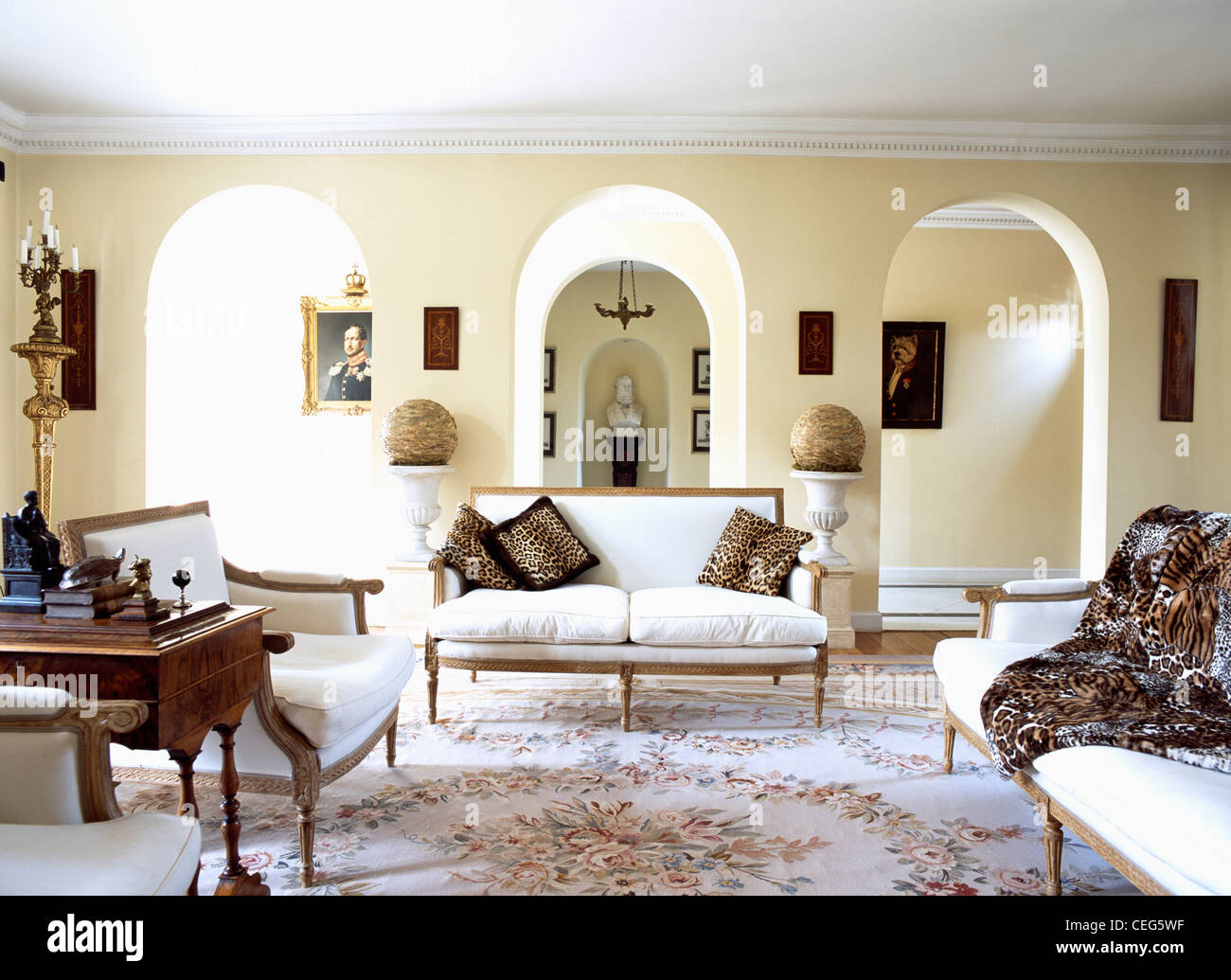 Leopard Print Living Room Leopard Print Cushions And Throw On White French Style Sofas In