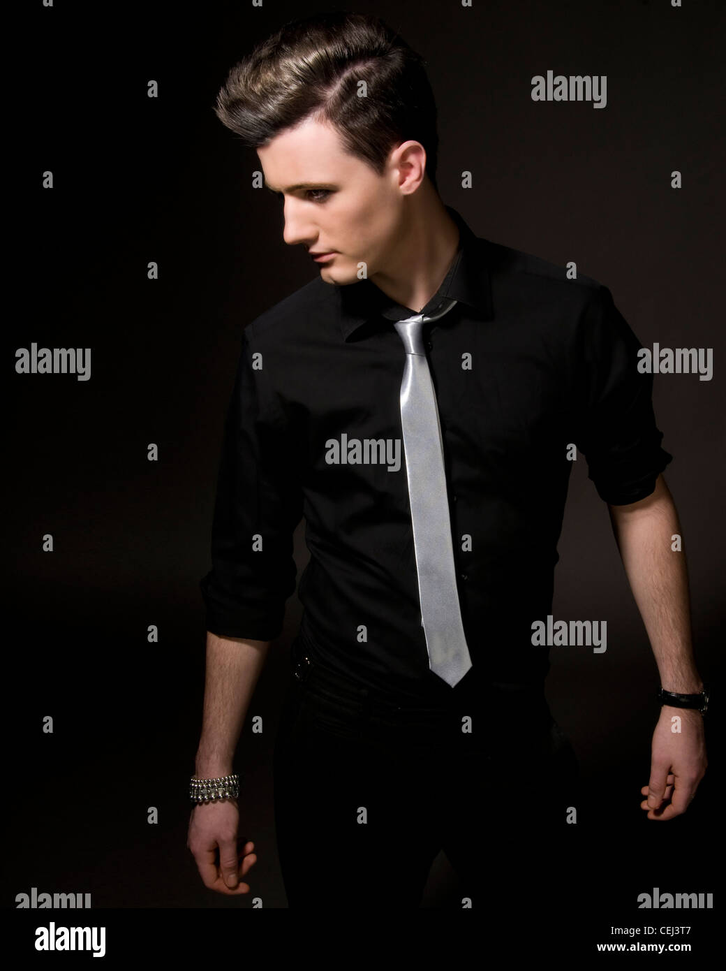 Male model in studio black shirt and silver tie stock for Black shirt and black tie