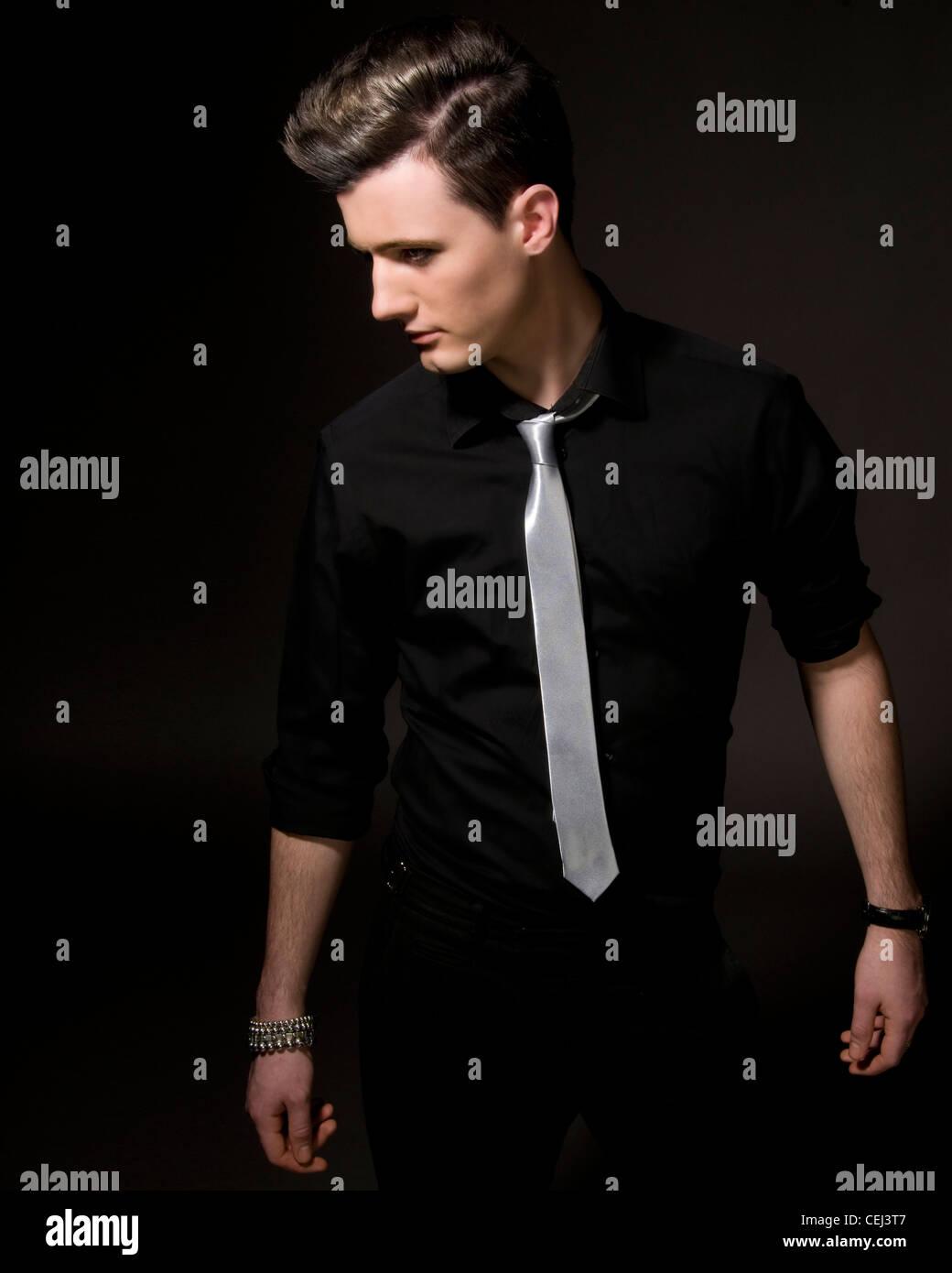 Male model in studio black shirt and silver tie stock for Black shirt black tie