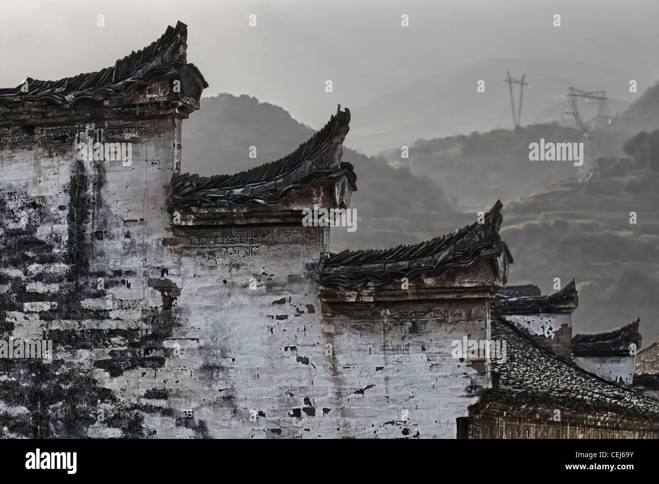 A Chinese Hui Style Wall And Roof Shaped Like Horse Heads Harmonized With Black White Color Mountains In The Background