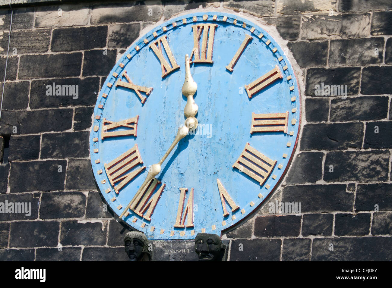 Church Clock With A Blue Face And Roman Numerals Stock