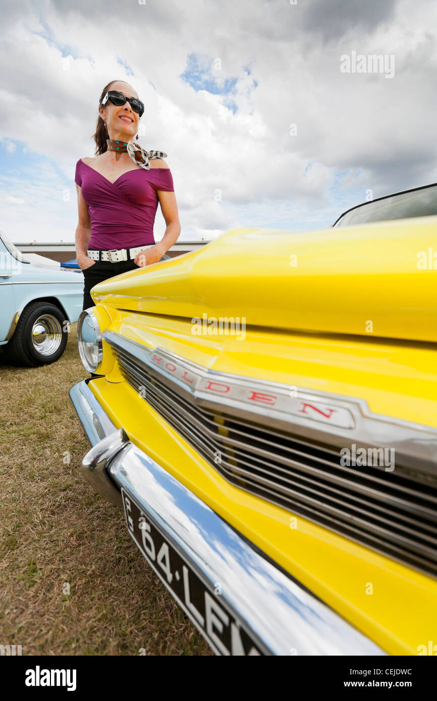 A woman poses with vintage cars, Brisbane, QLD, Australia Stock ...