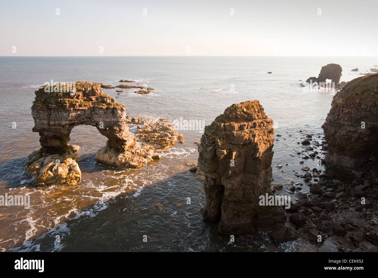 Sea stacks and sea arch on the North East coast at ...