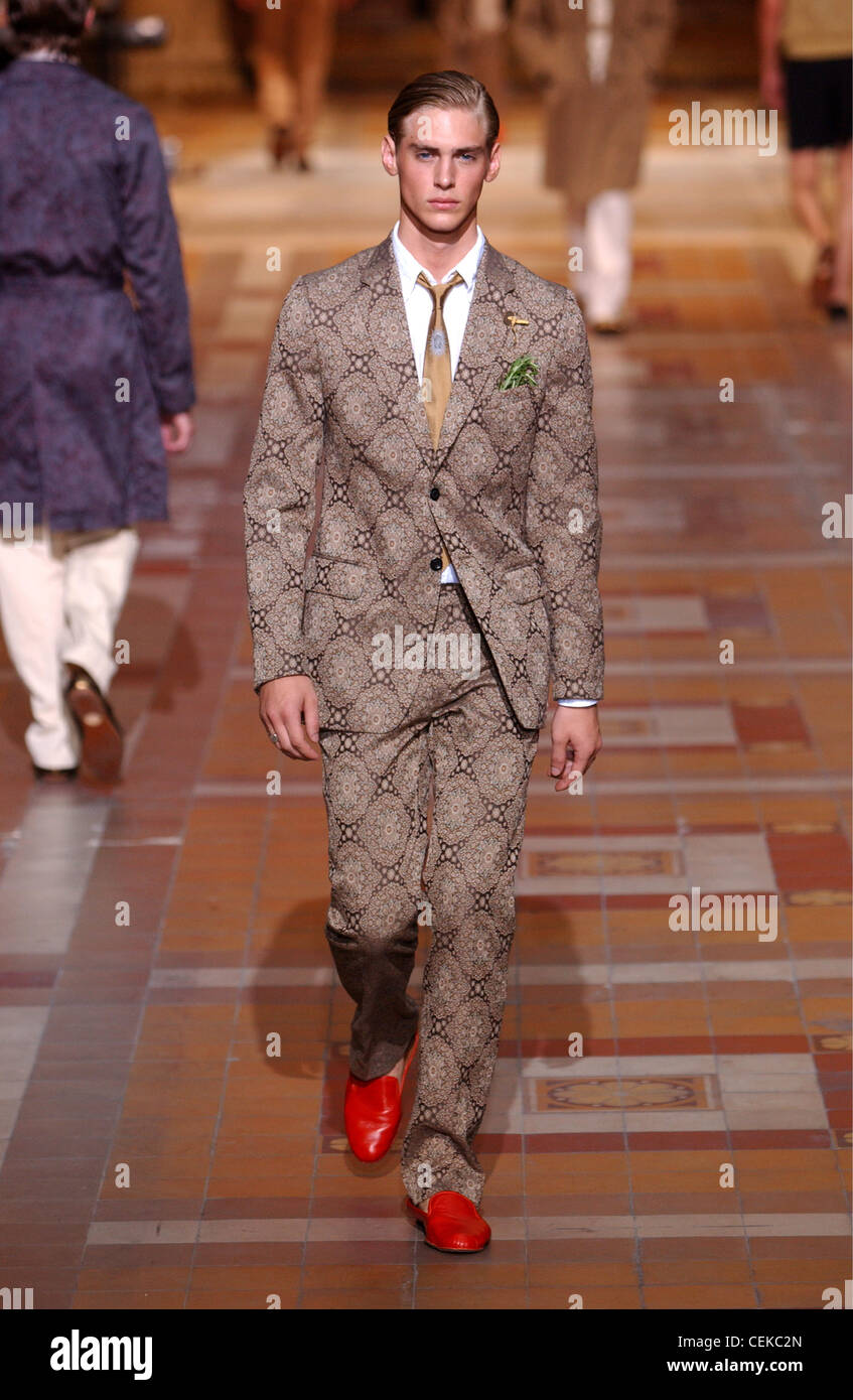 c0215c2a8607c7 Source http   www.alamy.com stock-photo-dries-van-noten-paris-menswear-s-s-male-model-wearing-paterned-brown-43452493.html.  Gold Suit Shoes