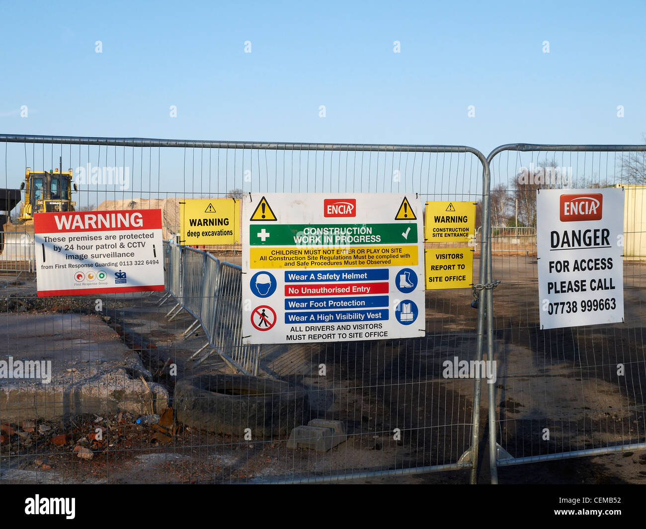 Health and safety signs on building site stock photo for Build a house website