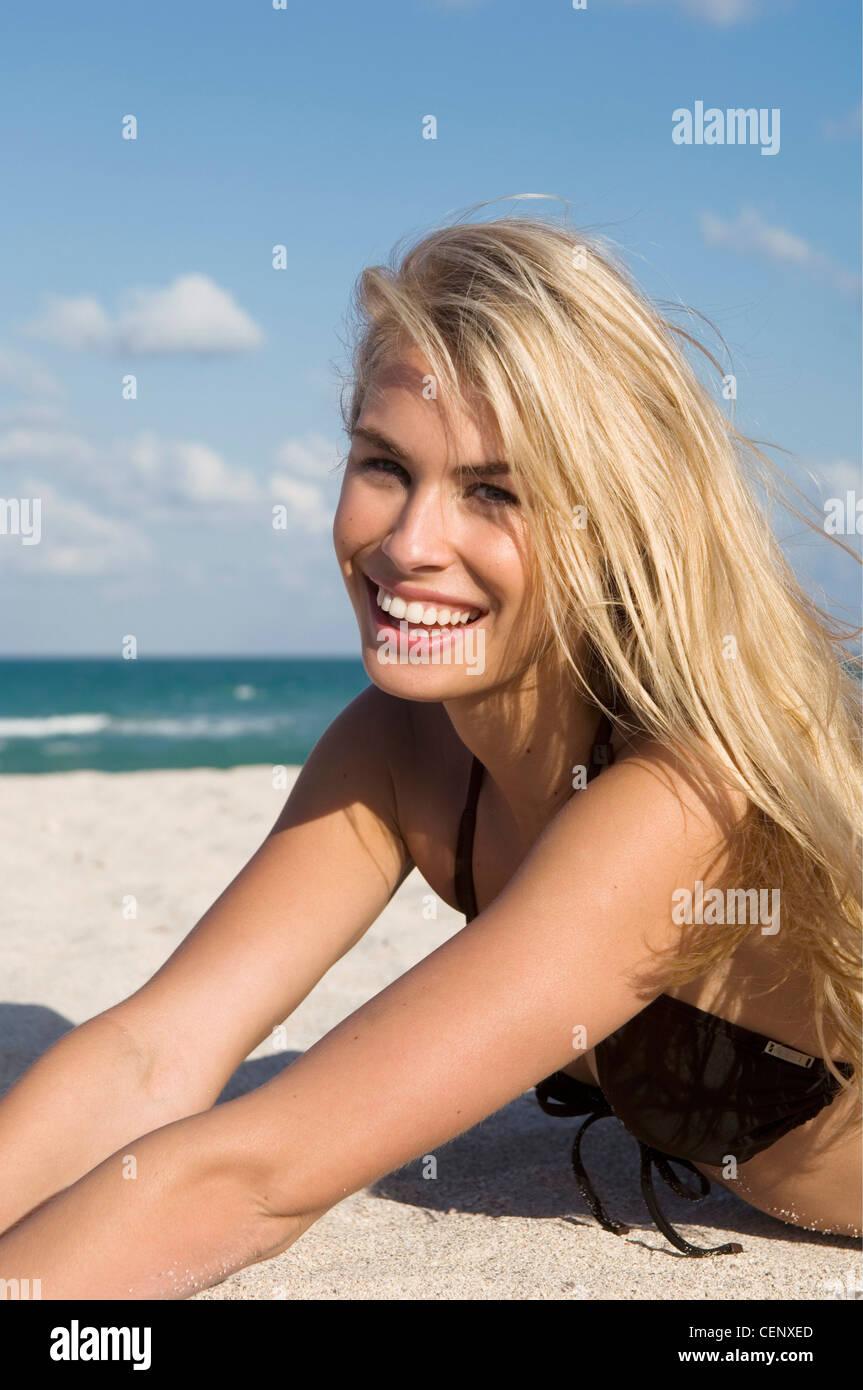 Female Very Long Blonde Hair Wearing Brown Bikini Lying