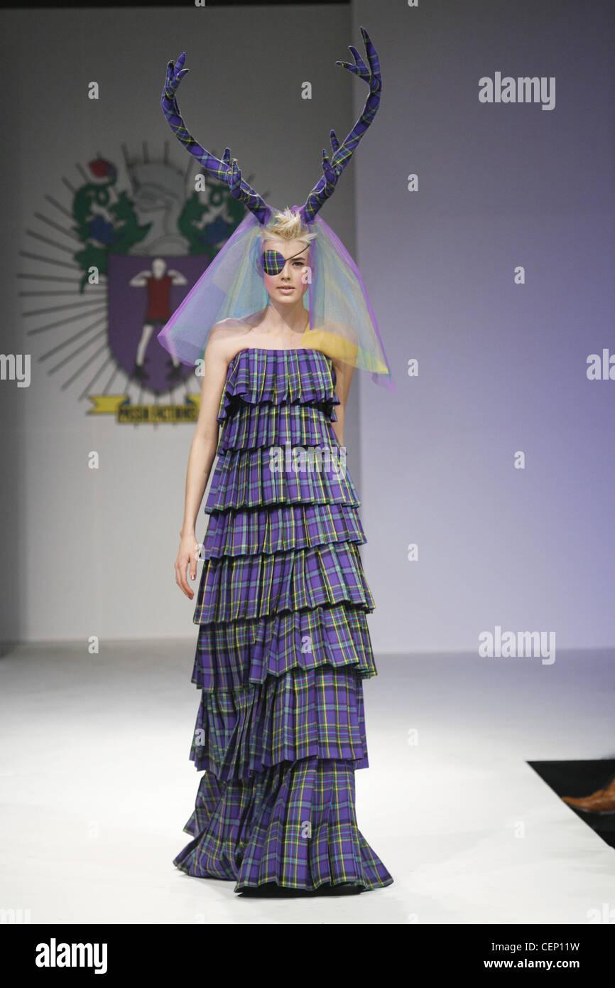 House Of Holland London Ready To Wear Autumn Winter Alternative Wedding  Dress: Model Agyness Deyn Eye Patch Wearing Purple