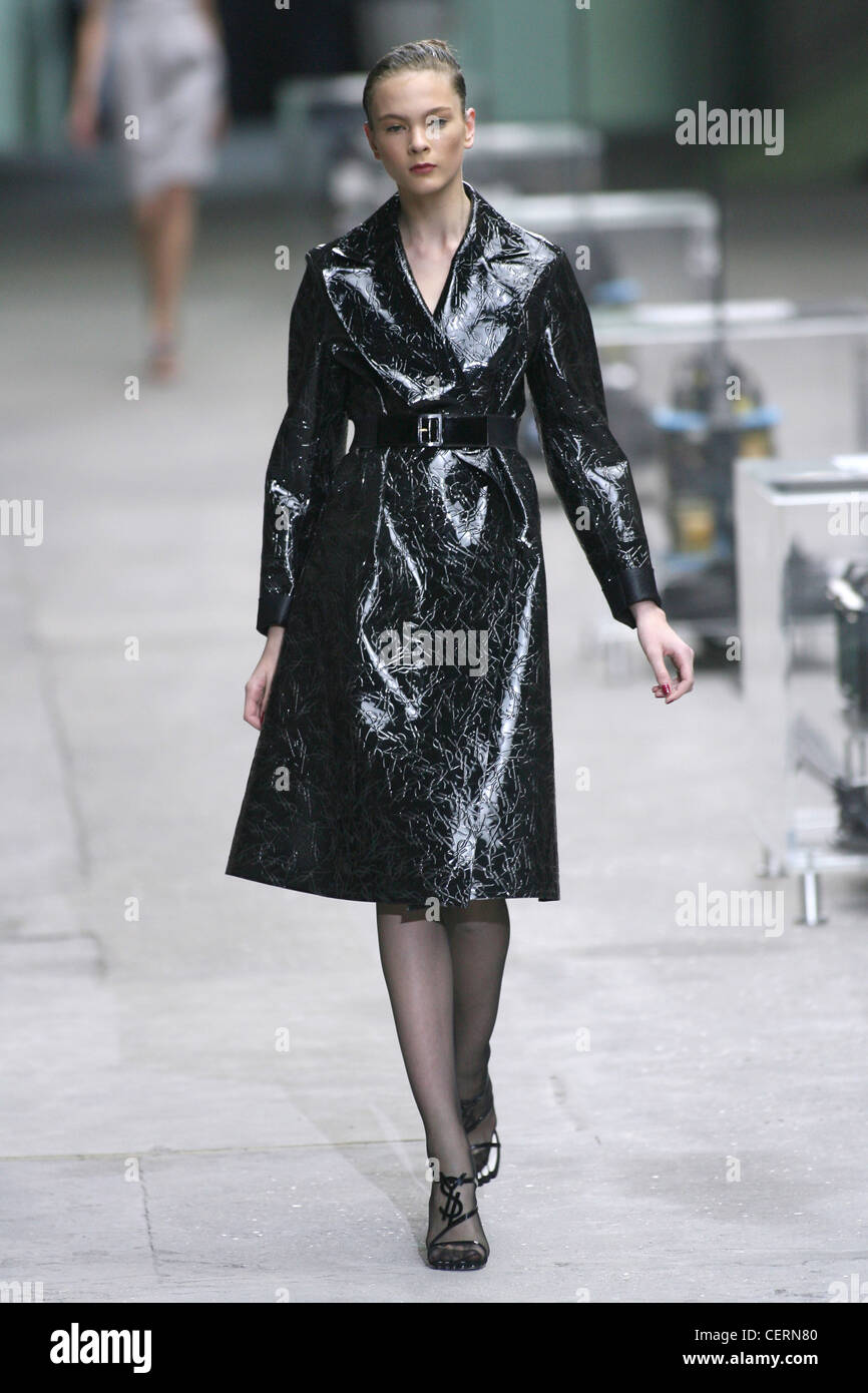 Belted shiny patterned black PVC trench coat, with sheer ...