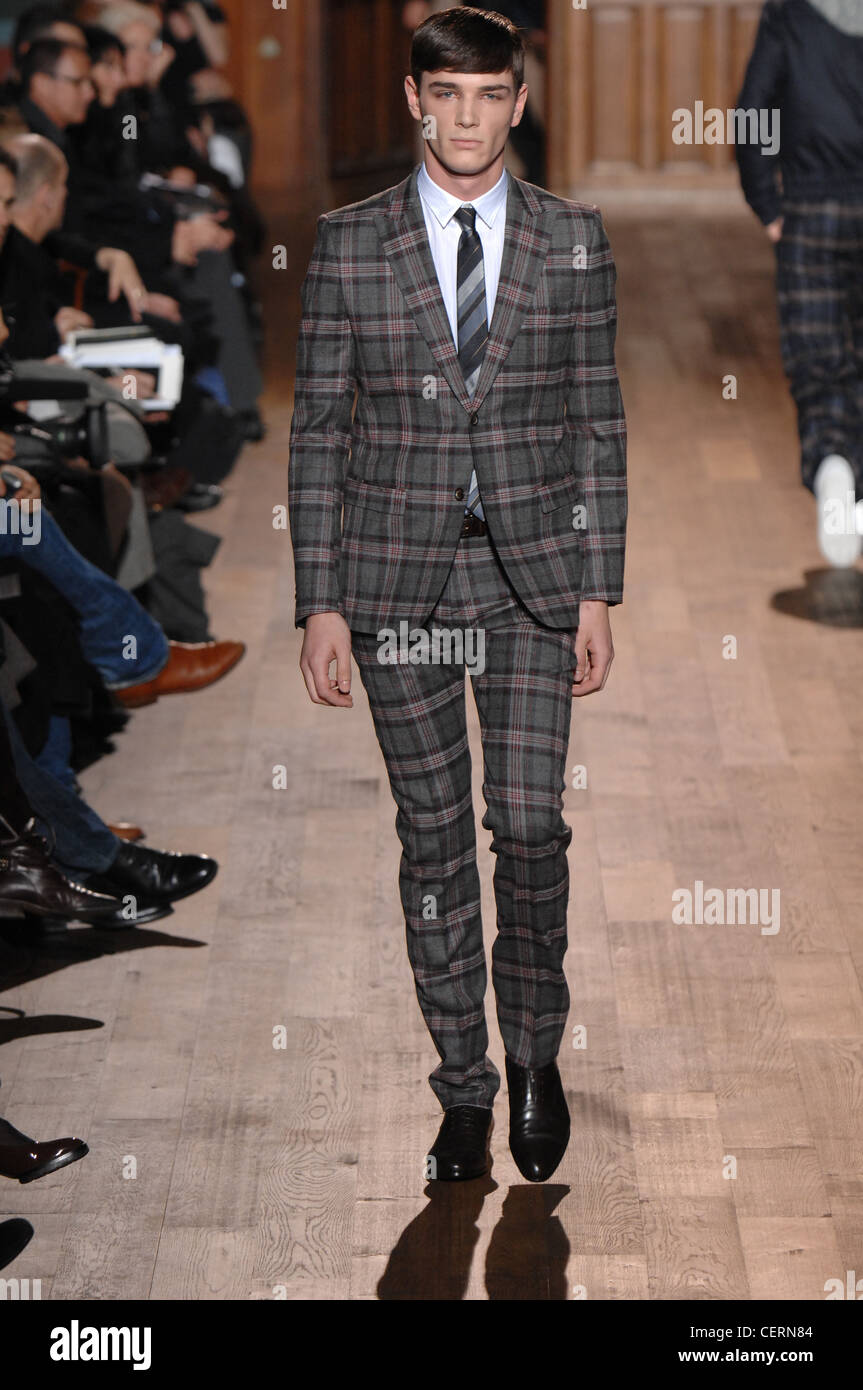 Grey Tartan Checked Suit With Bowl Cut Hair And Skinny Pants Stock