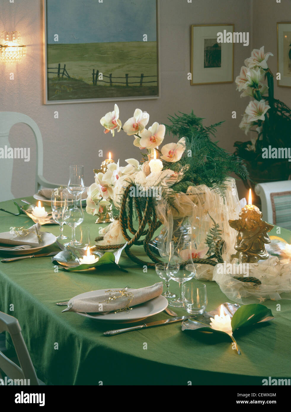 Christmas Table Setting With Green Table Cloth Flower