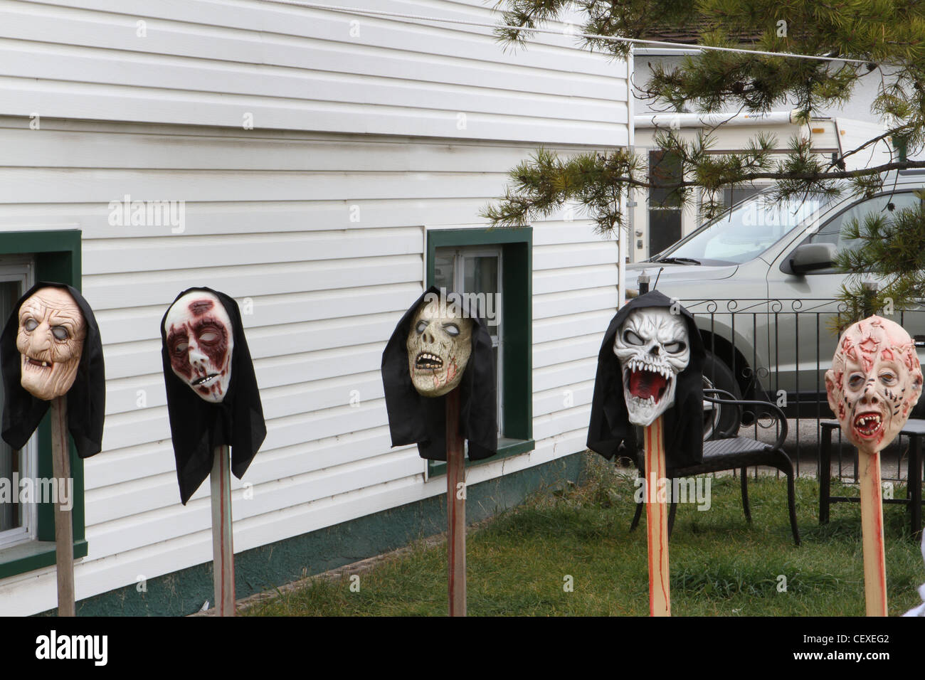 Scary Halloween masks in the front yard Stock Photo ...