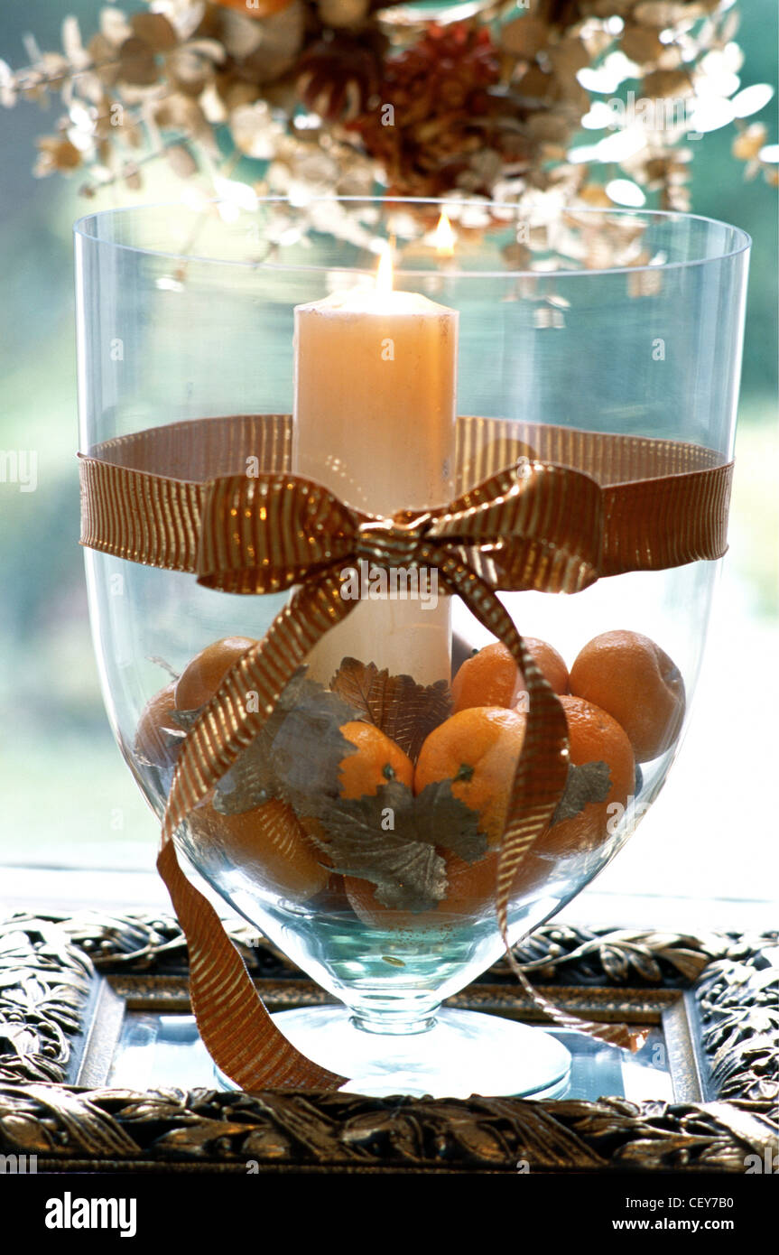 Decorating gold at christmas large glass vase filled oranges gold decorating gold at christmas large glass vase filled oranges gold leaves and lit candle wide gold ribbon tied in a bow around floridaeventfo Image collections