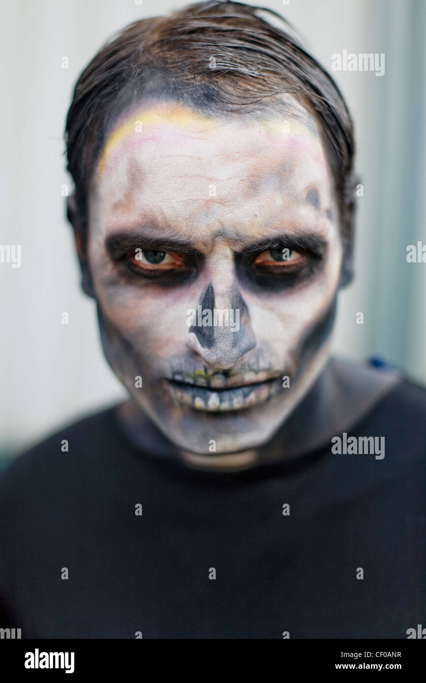 man made up with face paint to look like a skeleton haloween Stock ...