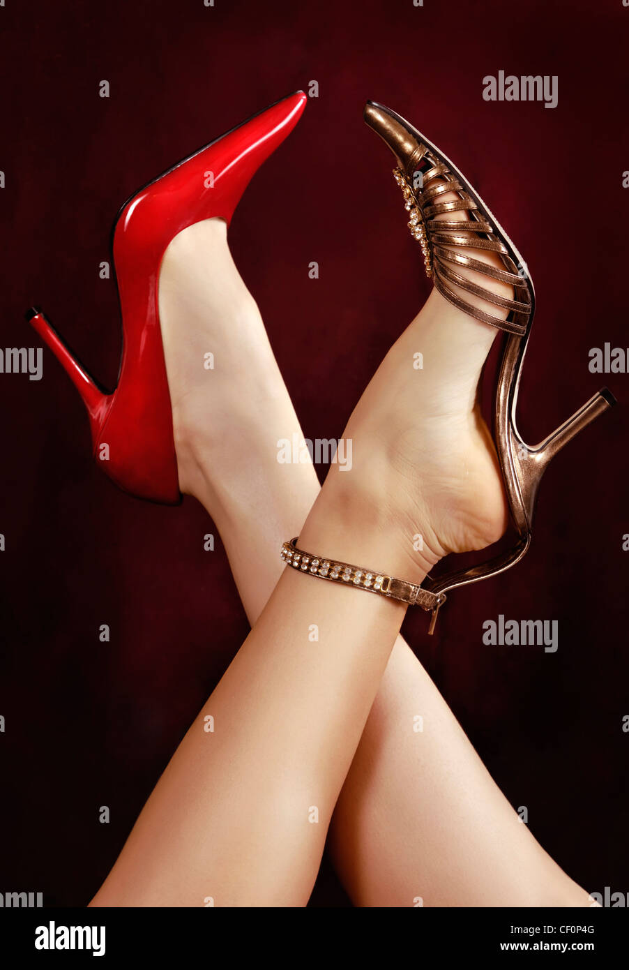Two women crossing their legs in sexy high heel shoes Stock Photo ...
