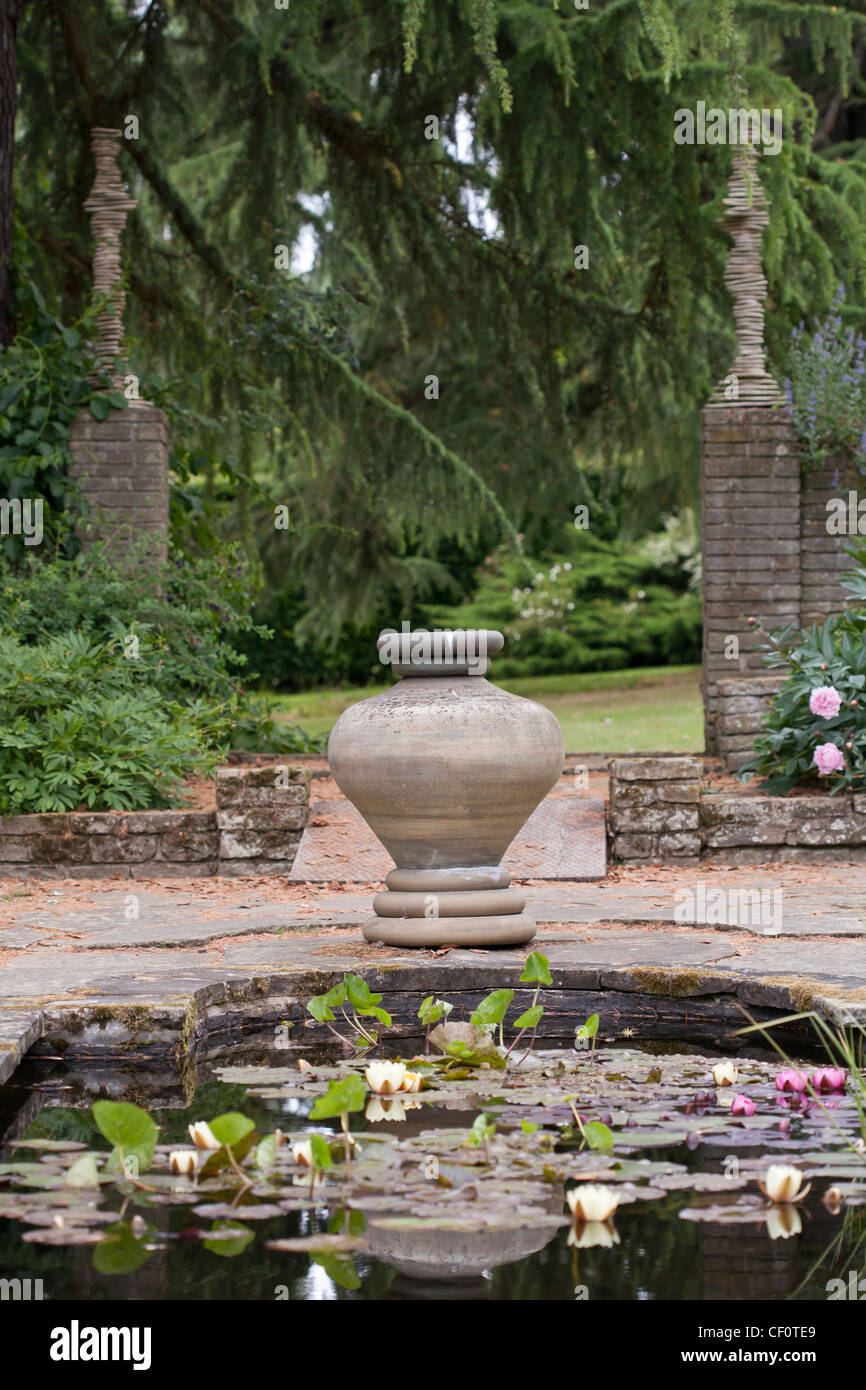 View across the pond towards the decorative stone urn in Italianate ...