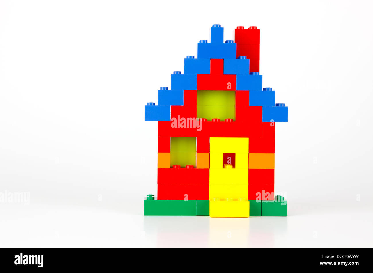A house built of red blue yellow and green traditional for Yellow and red house