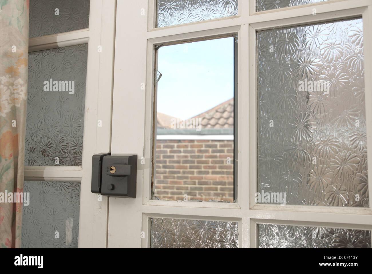 Decorating front door window film pics : Front door with a broken window pane from shattered glass Stock ...