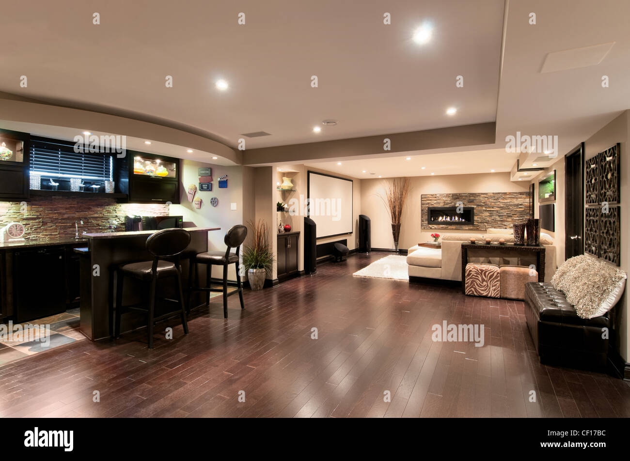 basement in luxury residential home with bar and home theater stock