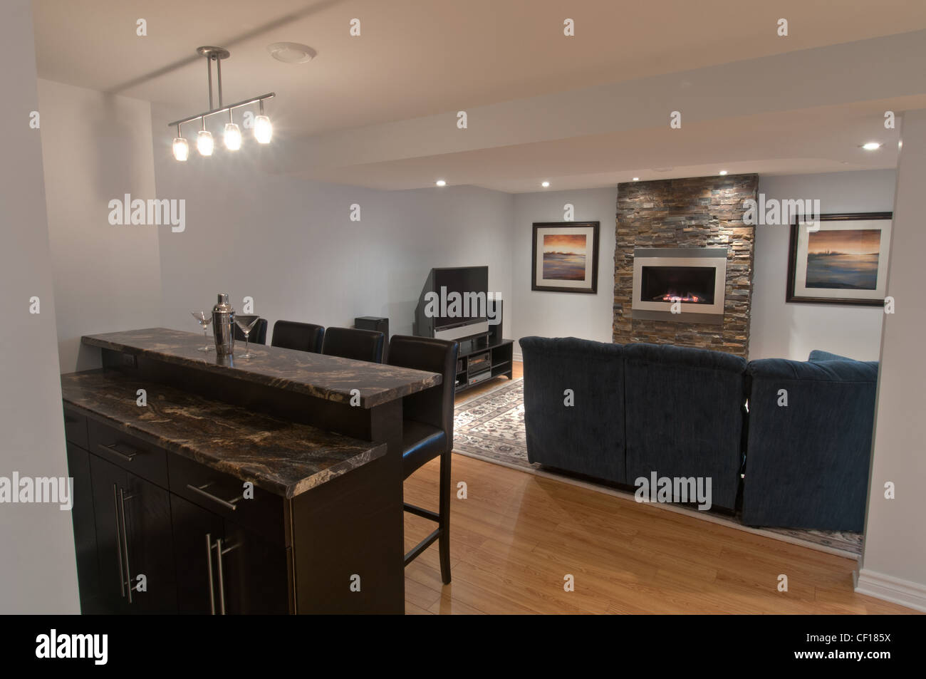 Luxury Basement Living Room With Gas Fireplace And Bar