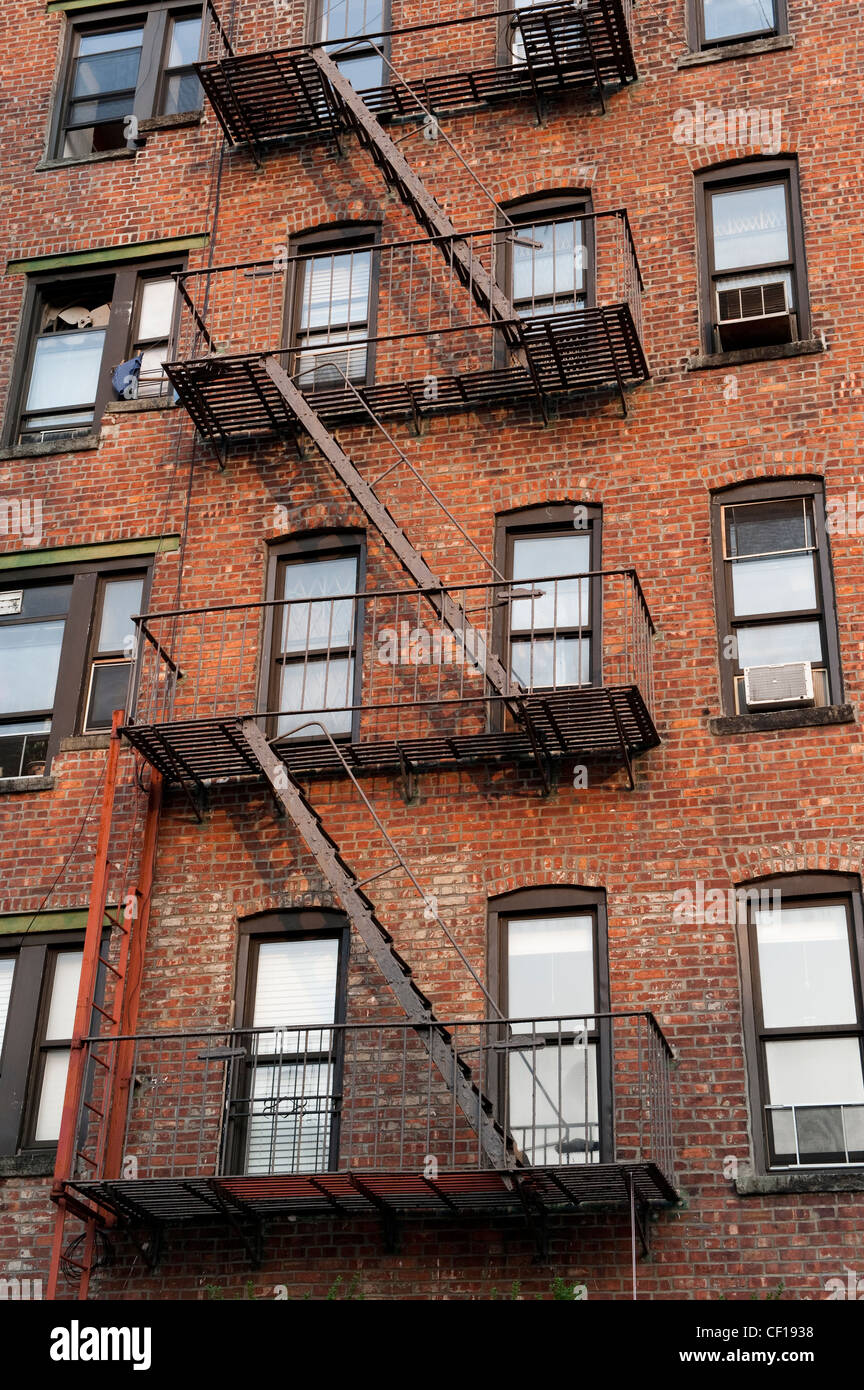 Fire Escape Ladders On Side Of Brick Apartment Buildings New York