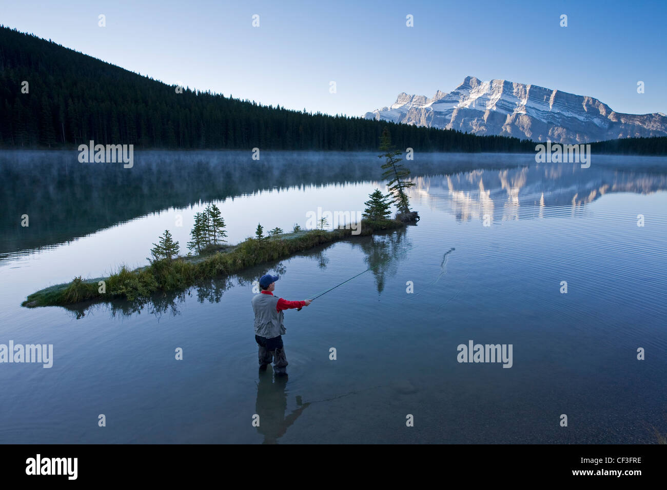 Middle aged male fly fishing in two jack lake banff for Fishing in banff