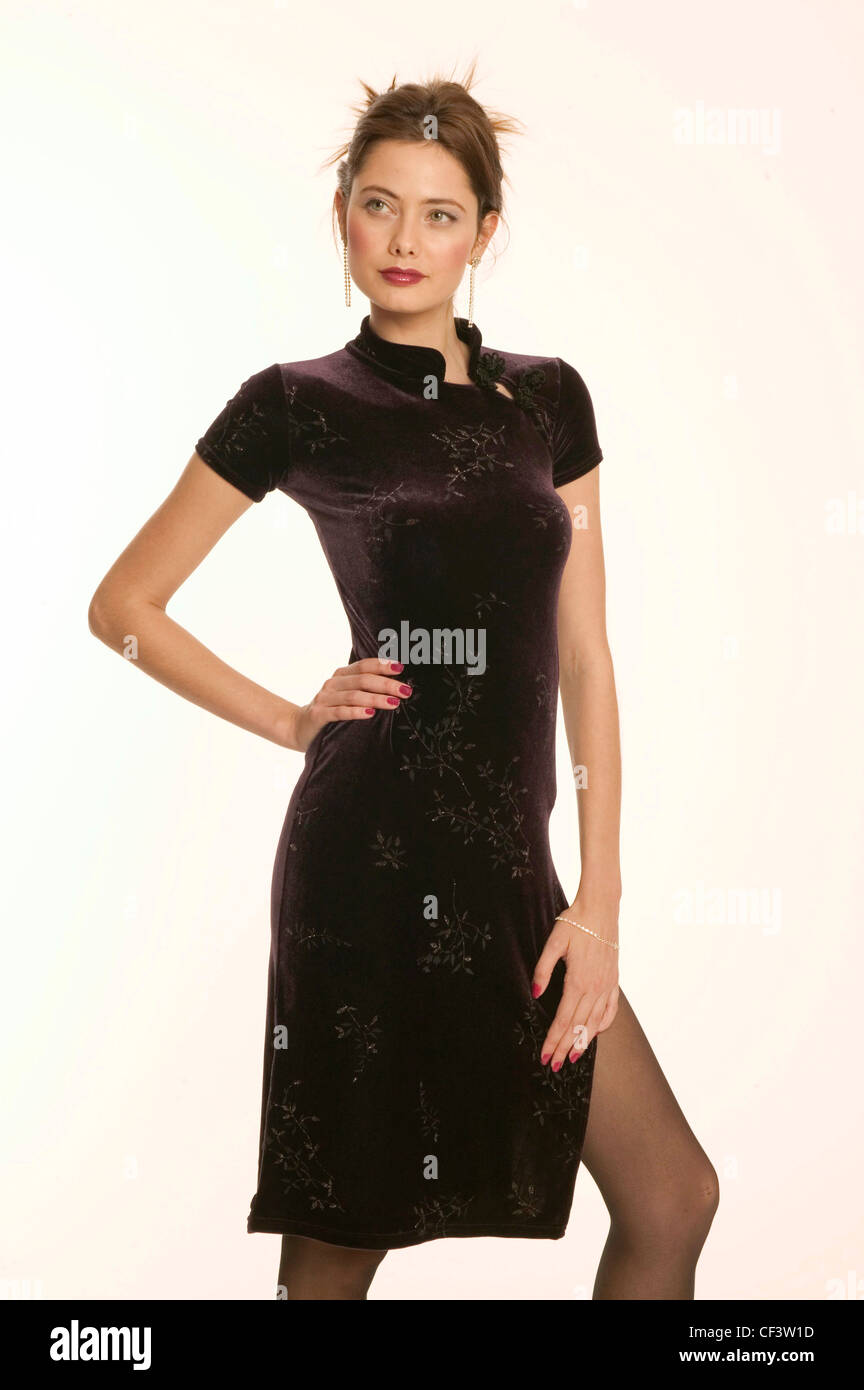 Black dress with red lipstick - Female Brunette Hair Off Face Red Lipstick And Red Nail Polish Wearing Silver Dangly Earrings Knee Length Black Velvet