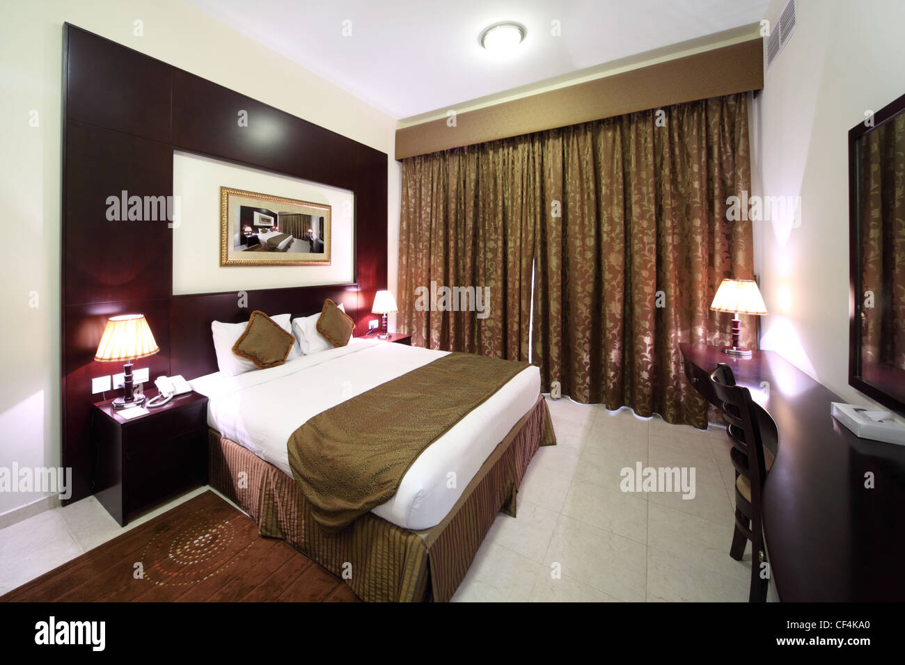 bedroom side view. Bedroom With White Walls, Closed Curtain And Big Double Bed Side View