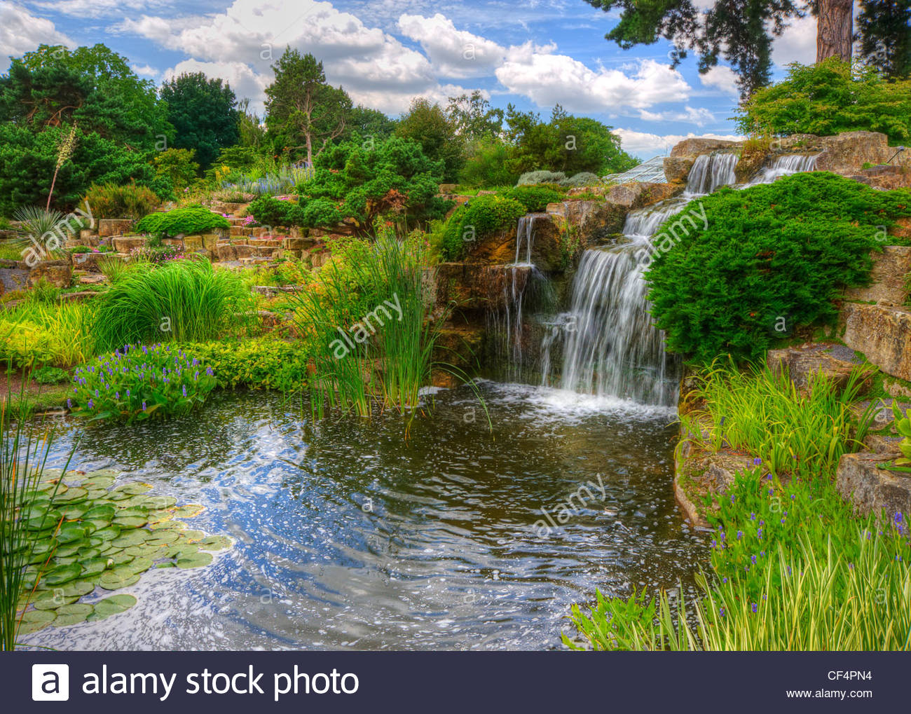 Waterfall in the Rock Garden at Kew Gardens. - Stock Image