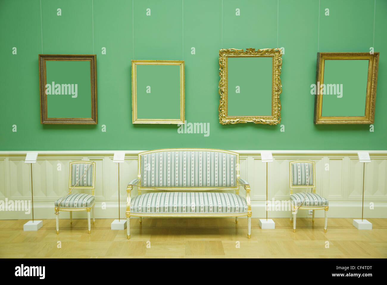 picture frames in green room of museum stripes chair and sofa with golden wood - Museum Frames