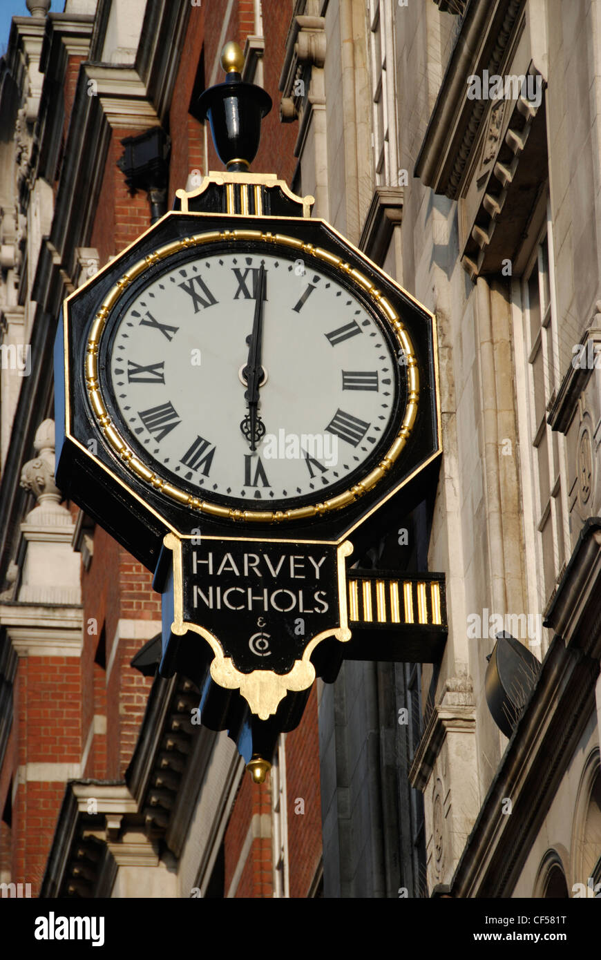 Exterior view of a clock face on the wall of harvey nichols stock exterior view of a clock face on the wall of harvey nichols department store amipublicfo Choice Image