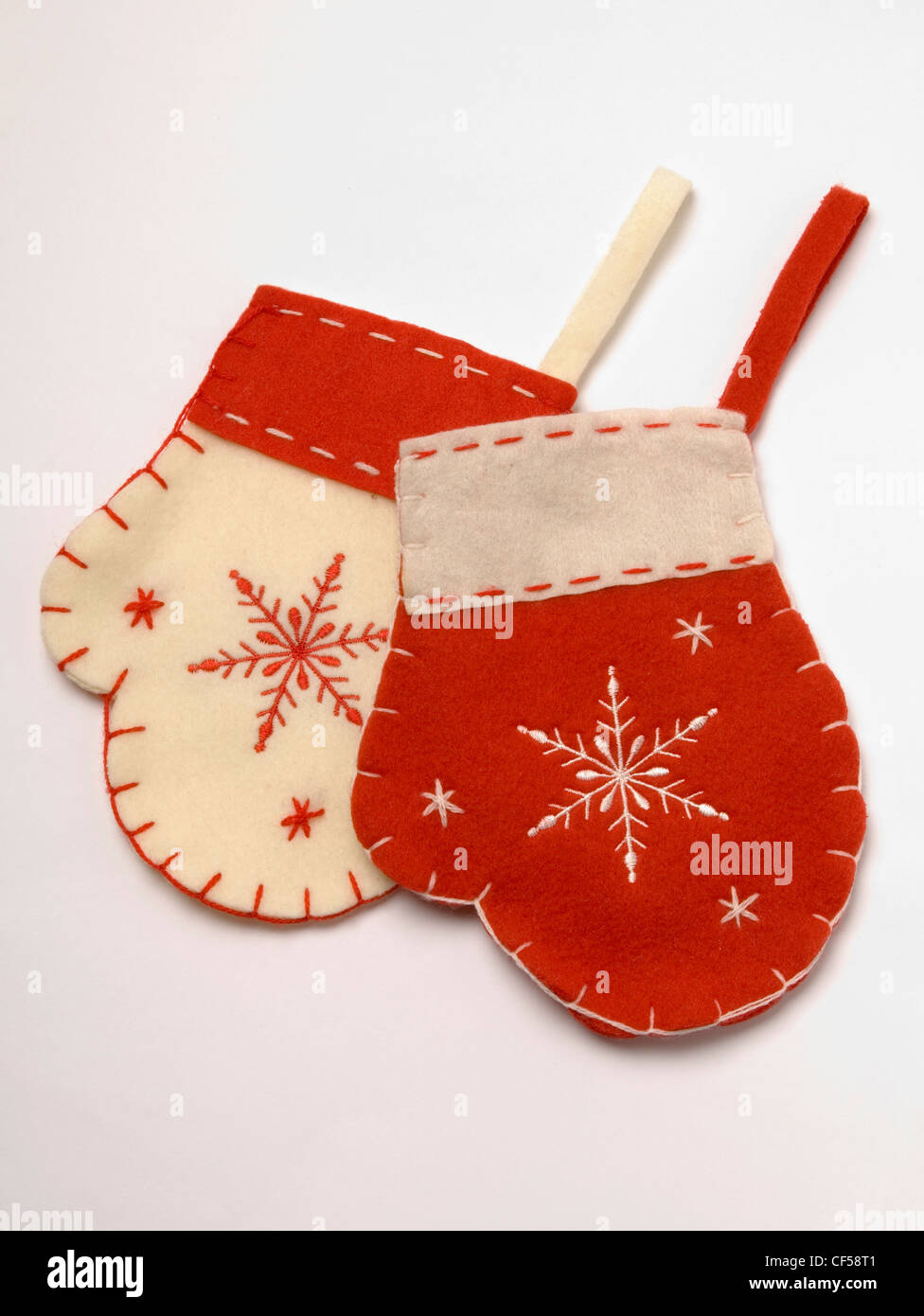 Mitten christmas decorations - Stock Photo Two Red And Cream Felt Mitten Shaped Hanging Christmas Tree Decorations Contrast Stitching And Embroidered Snowflake Pattern