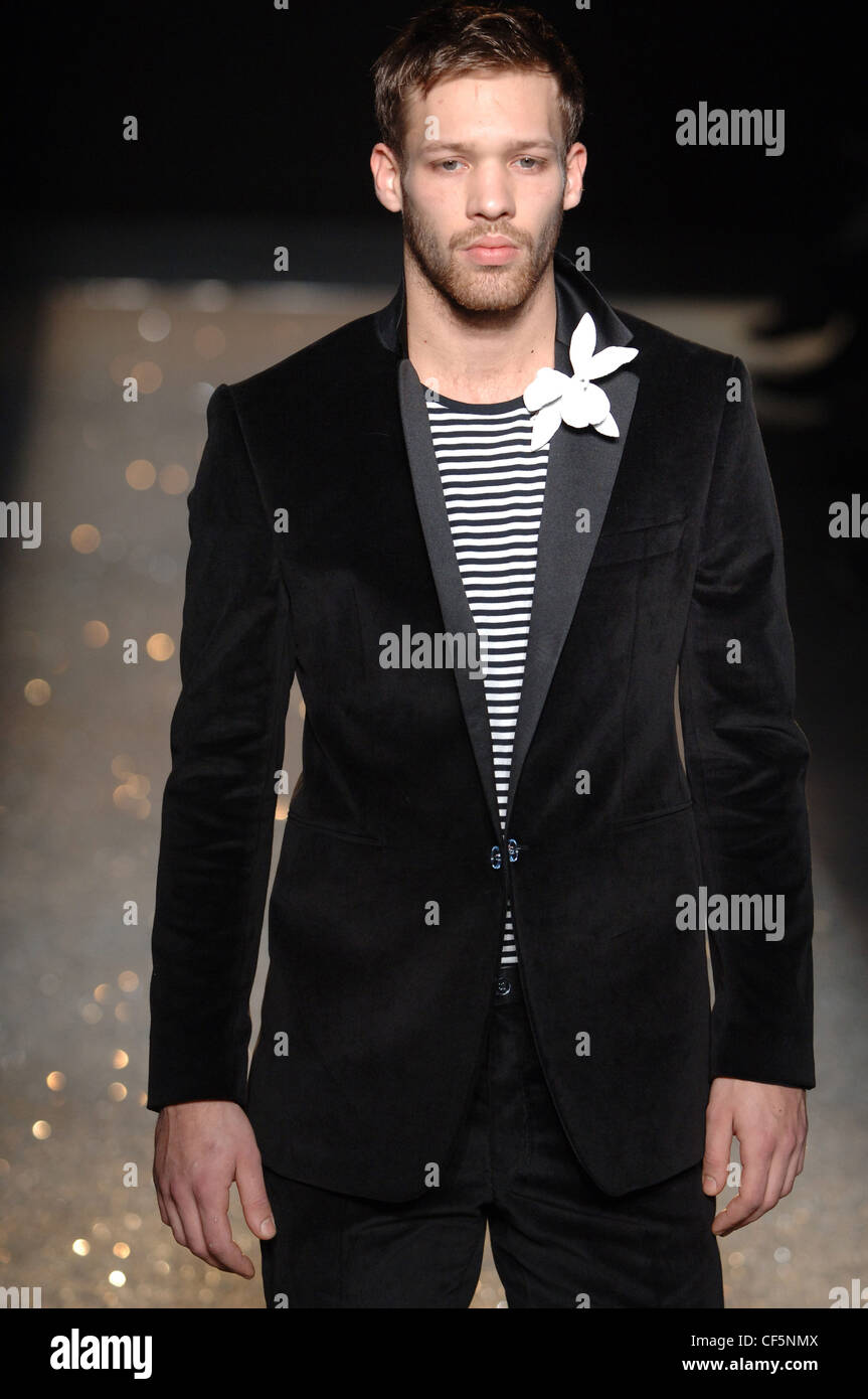 Black t shirt with suit - Emmanuel Ungaro Ready To Wear Menswear Paris A W Blonde Male Wearing A Black Suit Over A Black And White Striped T Shirt And A
