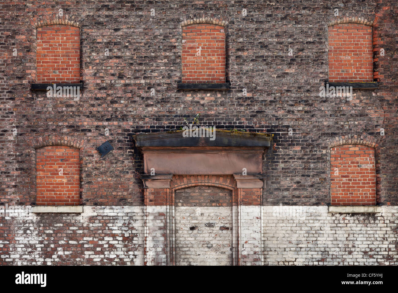 Bricked Up Windows And Door Of An Old Warehouse