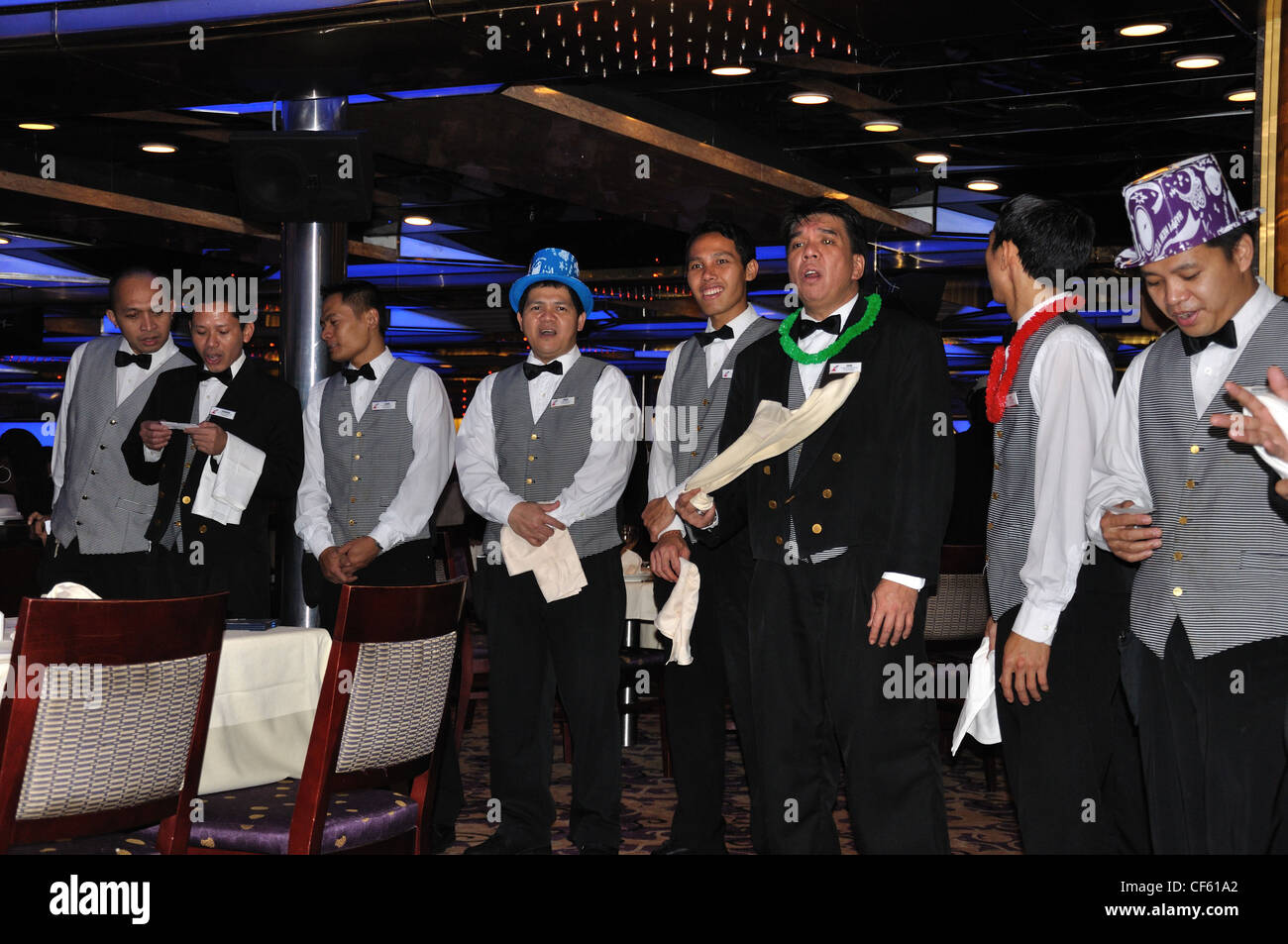 Restaurant Staff Singing During Dinner On Carnival Cruise Ship - Staff on a cruise ship