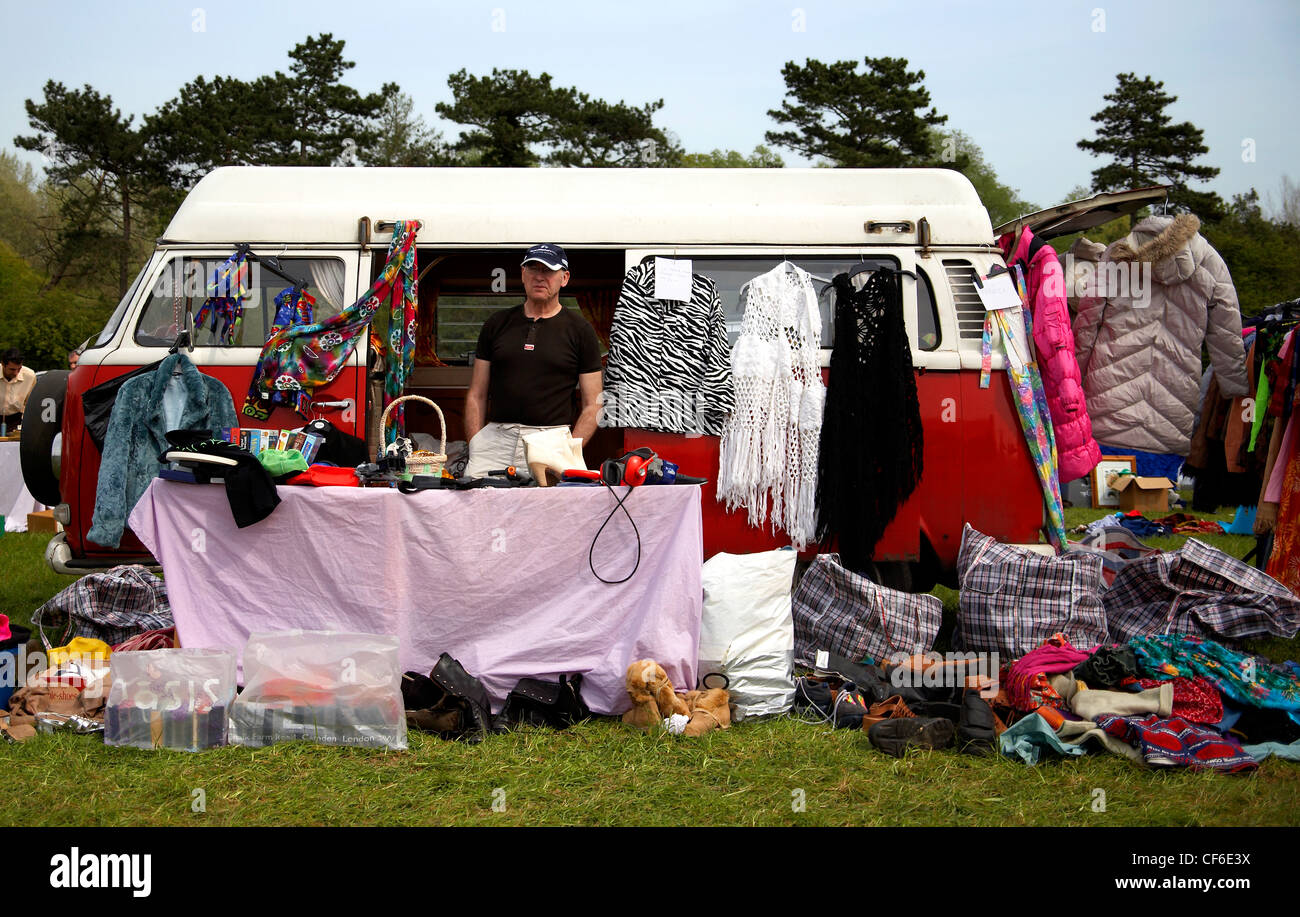 A man selling things at a car boot sale stall car boot sales are a
