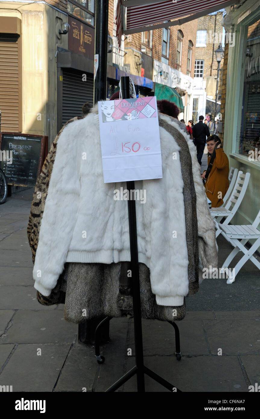 Vintage Fur Coats For Sale At £150 Each On Clothes Rack Outside