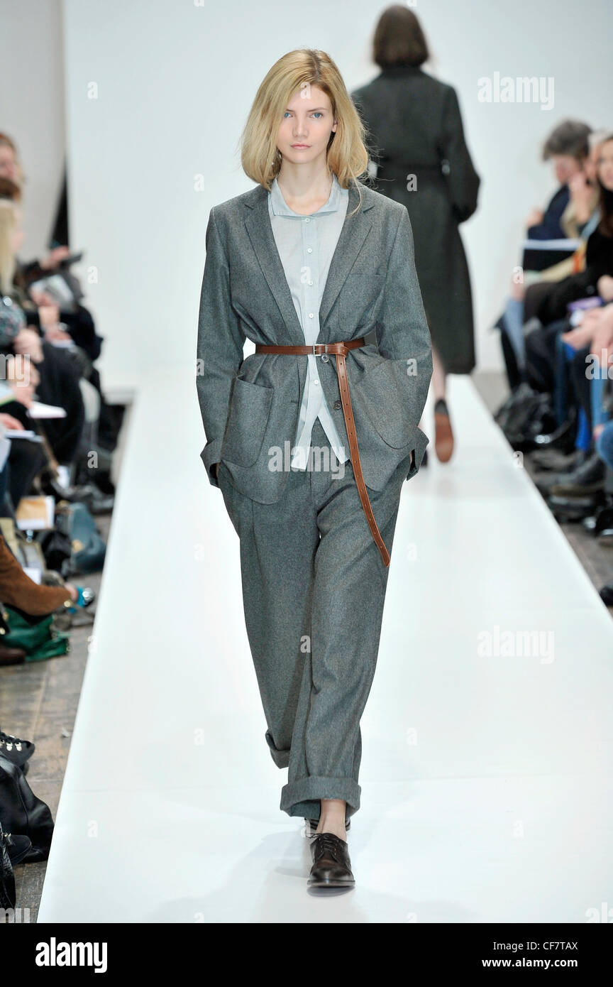 Grey shirt, baggy grey trouser suit with brown belt and black ...