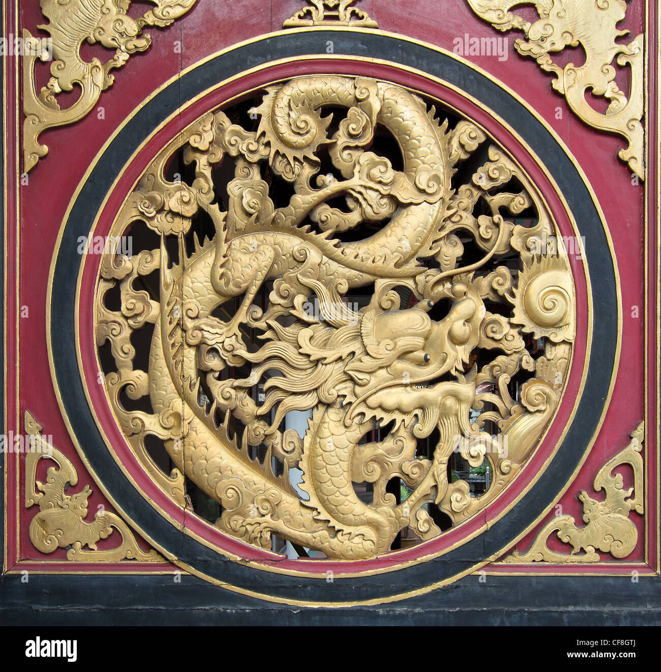 Wood carving chinese dragon on outside temple door with for Wood in chinese